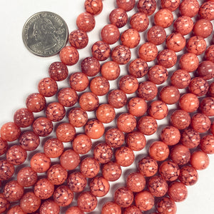 "8mm round, coral darker painted splatter, vintage lucite beads,  sold per 16"" strand"
