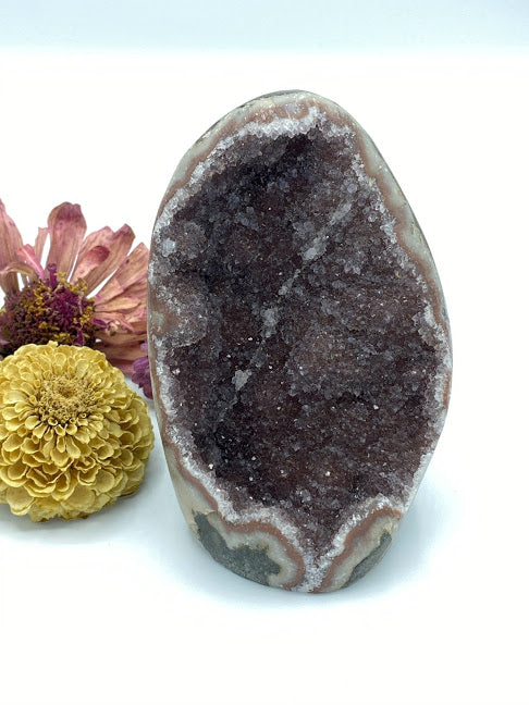 "Druzy amethyst geode free form self standing speciment, approximated 4.5"" high. Sparkly purple with a thin white quartz vein."
