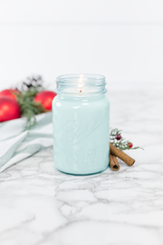 Christmas Day 16 oz blue jar candle