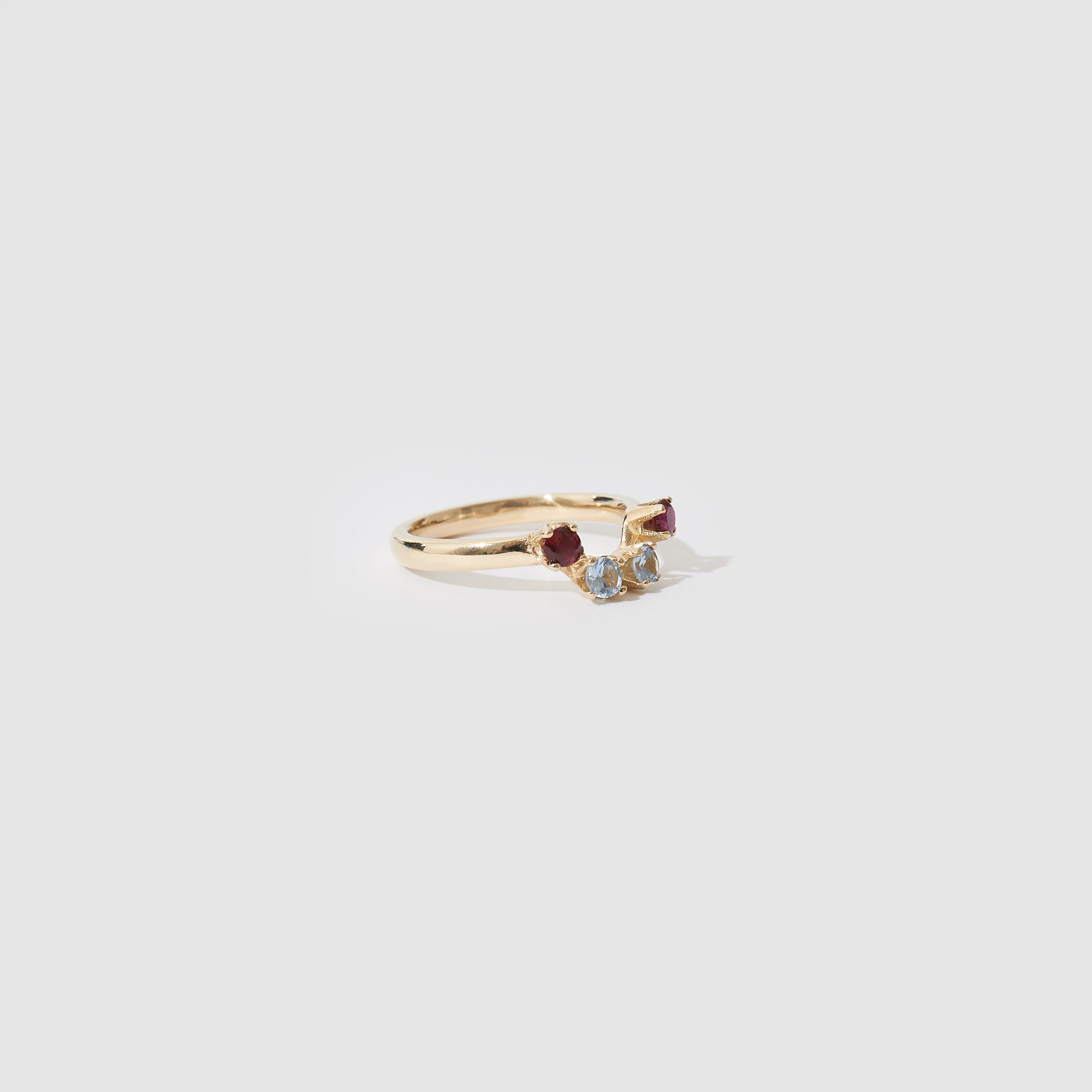 Four Stone Gold Ring - Blue Topaz and Ruby CZ