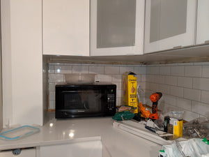 How to replace drywall adjacent to wall cabinets and then tile over it?