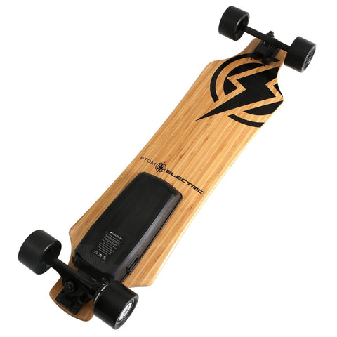 Atom H10 Electric Longboard leaning wooden bottom view