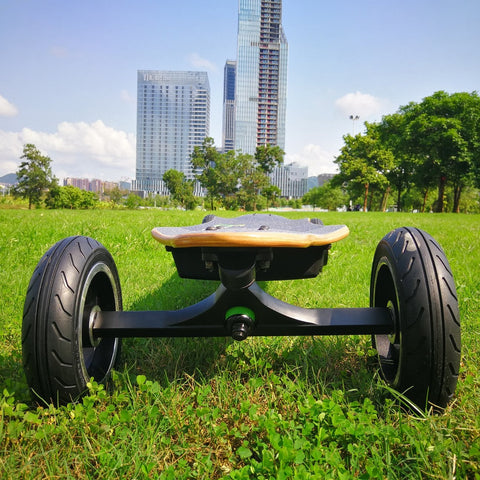 Image of AEboard AE2 All Terrain Electric Skateboard on the grass front view