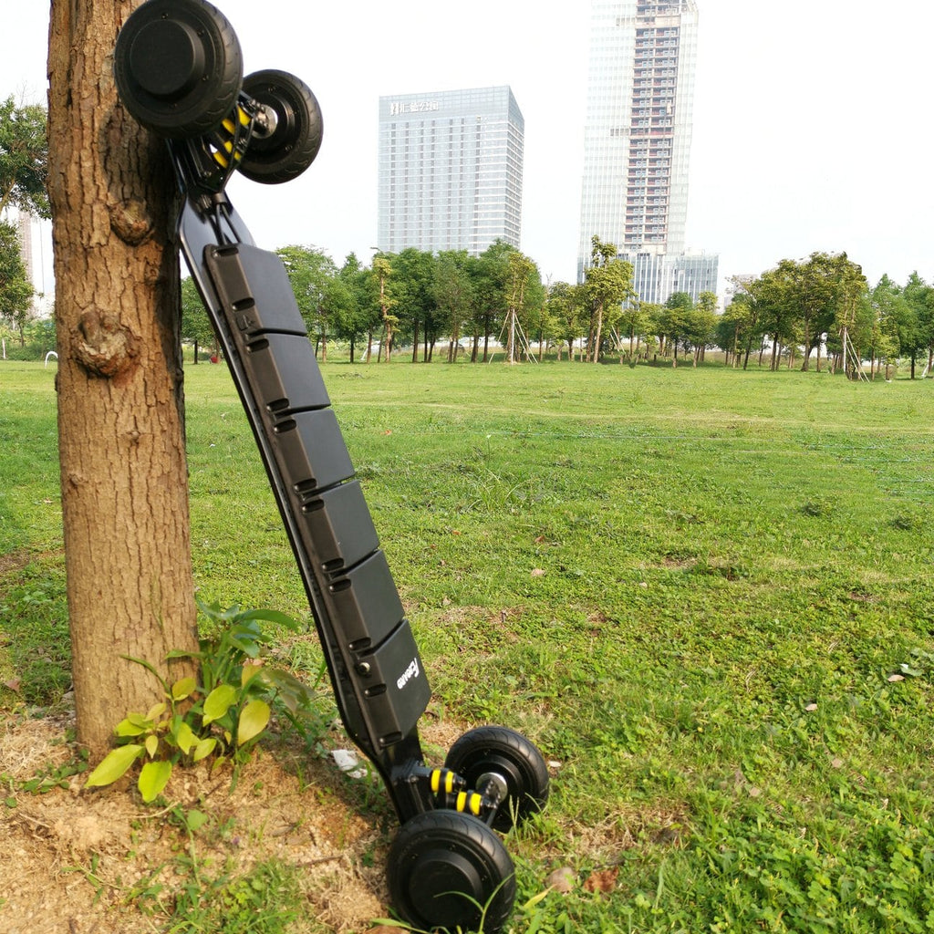 AEboard GT Electric Longboard Leaning Against Tree