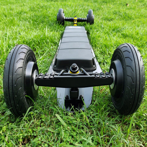 Image of AEboard GT Electric Longboard Upside Down on the grass