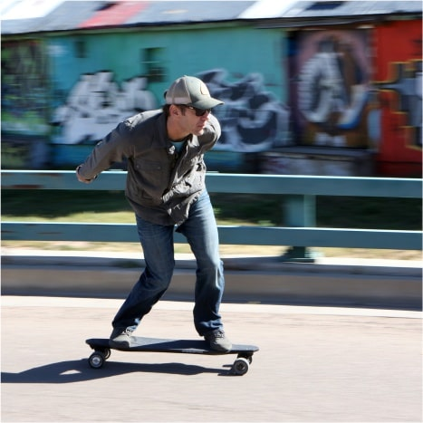 Image of Atom H16D Electric Longboard action shot of rider