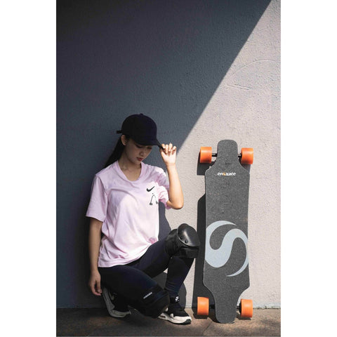 Image of Enskate R3 Electric Skateboard girl and board