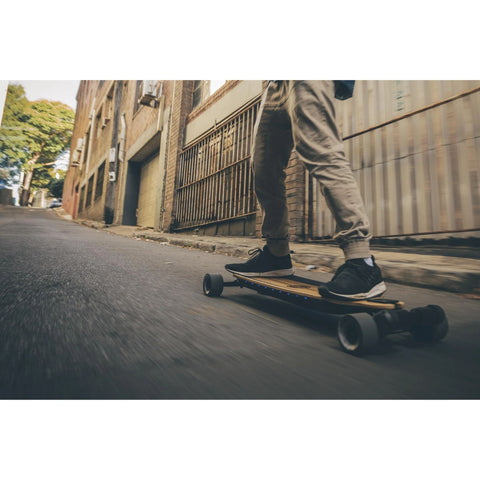 Image of Evolve Bamboo GTR Street Electric Skateboard action shot