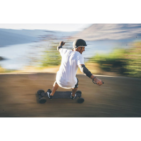 Image of Evolve Carbon GTR AT Electric Skateboard action shot