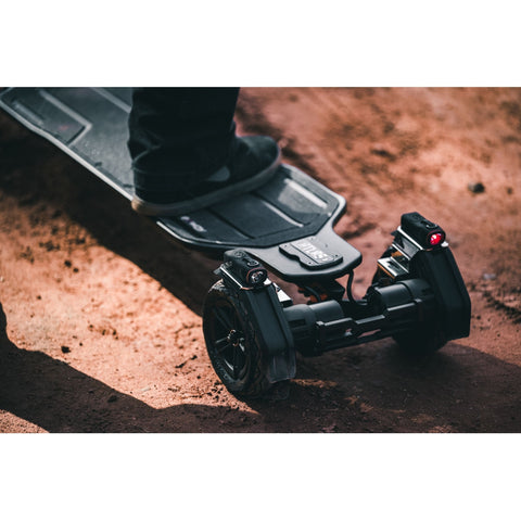 Image of Exway Atlas Electric Skateboard on dirt