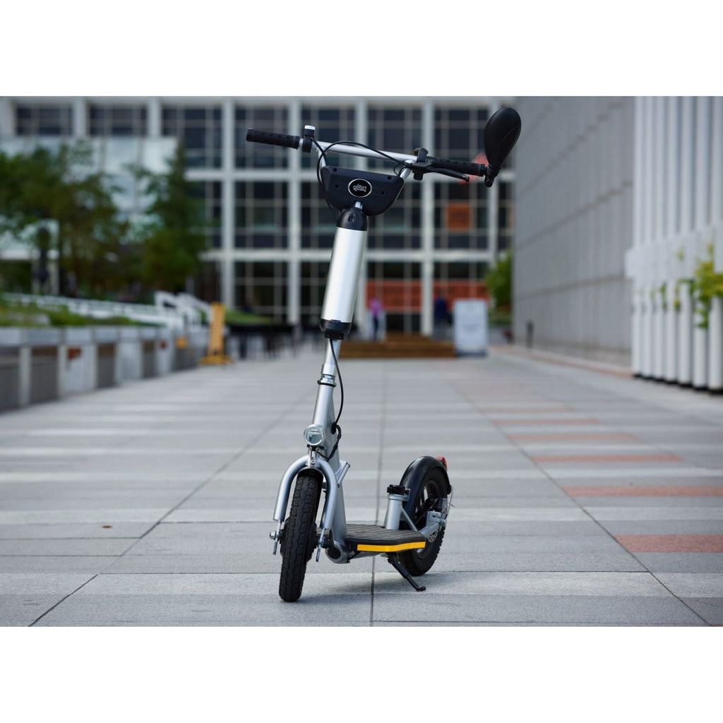Glion Balto Electric Scooter on sidewalk