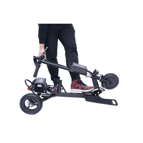 Image of Glion SnapnGo Electric Scooter folded with boy holding