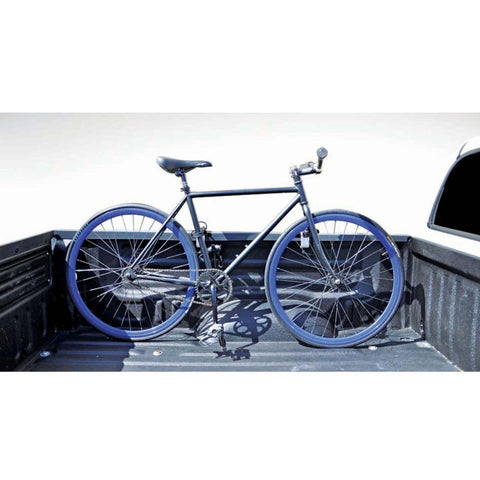 Image of INNO truck bike rack bike strapped to truck side view