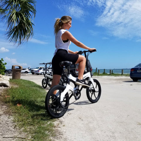 Image of Jupiter Discovery X7 Foldable Electric Bike girl riding bike