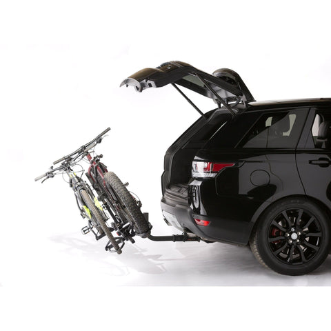 Image of KAC K2 Overdrive Sport Hitch Mounted Bike Rack trunk open and bikes tilted