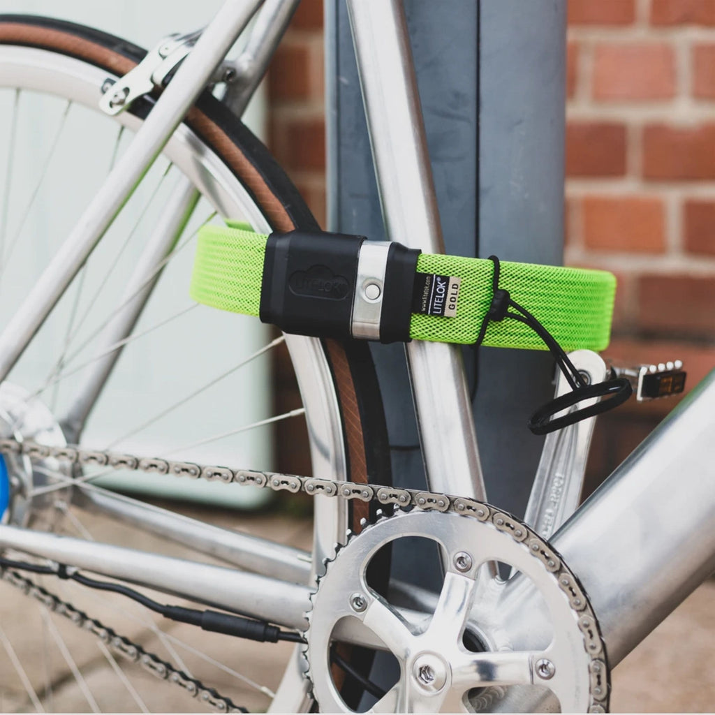 Litelok Gold Wearable Bike Lock green tied around bike