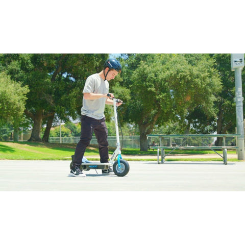 Image of Razor E300 Electric Scooter side view action shot