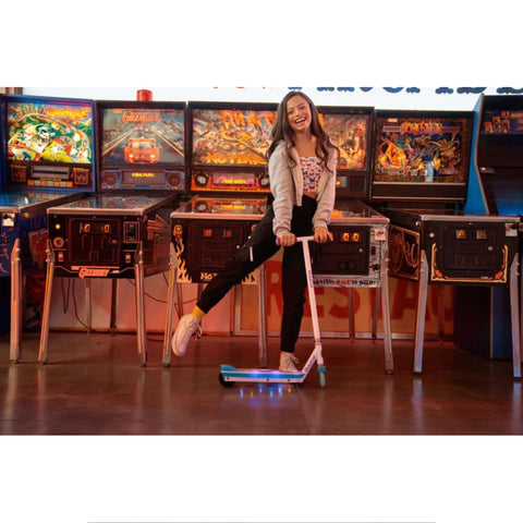 Image of Razor Party Pop Electric Scooter girl in arcade