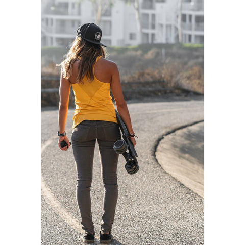 Image of Shark Wheel Shark Electric Power Skateboard woman action shot