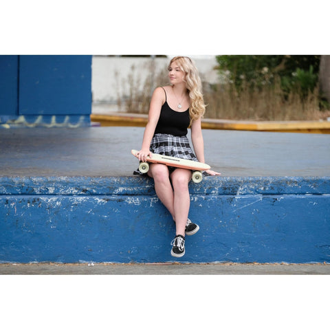 Image of Skatebolt Brisk Electric Skateboard girl holding board