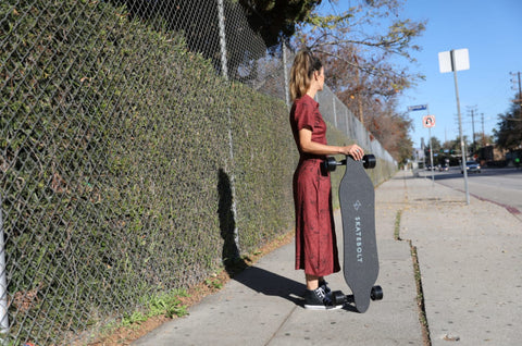 Skatebolt Breeze 2 Electric Skateboard sidewalk with a girl