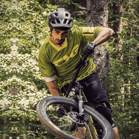 Image of TSG Scope Helmet action shot with bike downhill