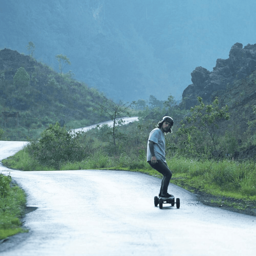 Raldey Carbon AT V.2 Off-Road Electric Skateboard live riding shot on windy road
