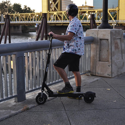 Image of Voro Emove Touring Electric Scooter On Bridge