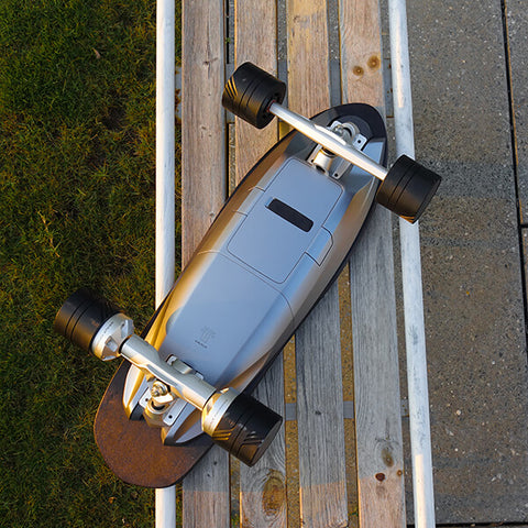 Walnutt Spectra X Electric Skateboard In Outdoor Back View Bench