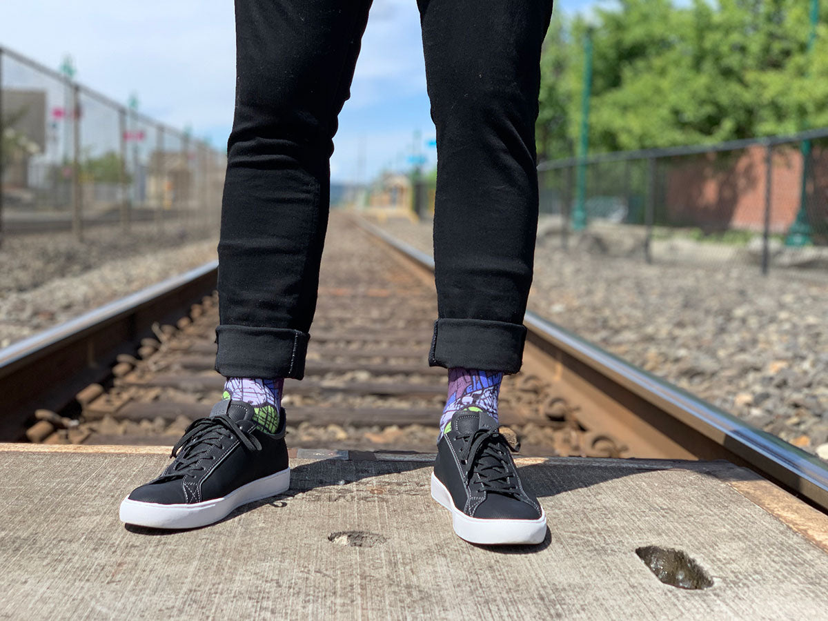 Man Wearing Berlin Map Socks On Railroad