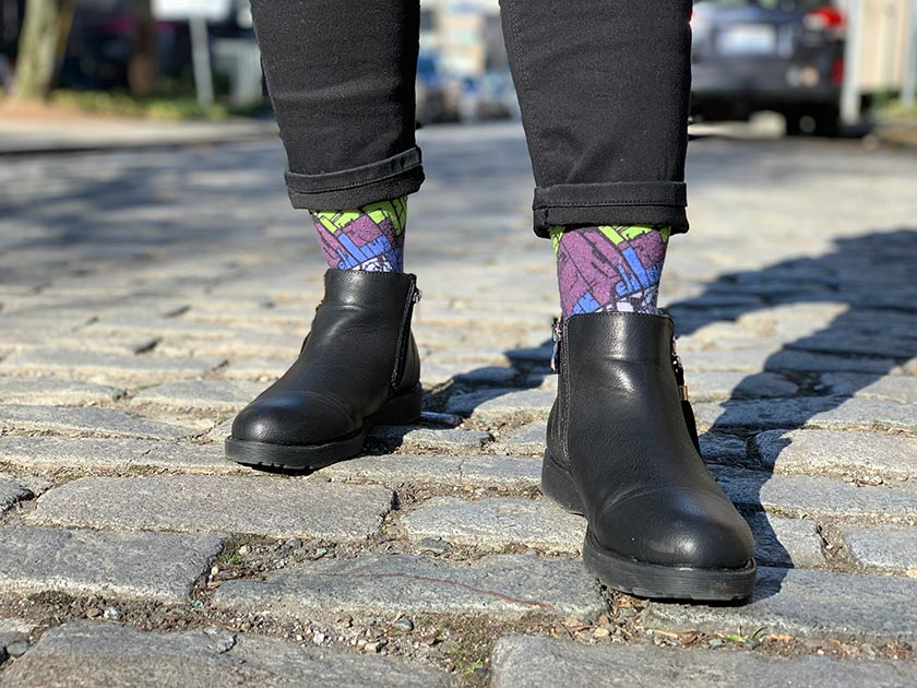 Woman Wearing Berlin Map Socks On Cobblestone
