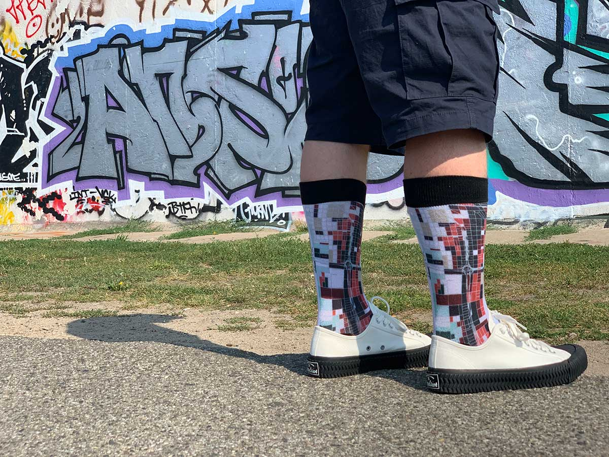 Man Wearing Chicago Map Socks At Berlin Wall