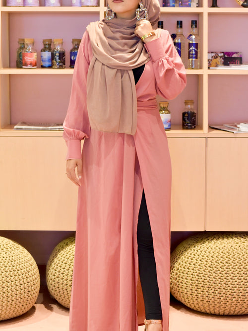 Pink abaya dress with hijab and jeans