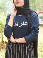 Navy Blue tshirt with name printed in arabic in gold worn with head scarf and pinstripe pants