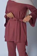 Girl wearing mauve top and pant set , trendy co-ords set with trendy hijab