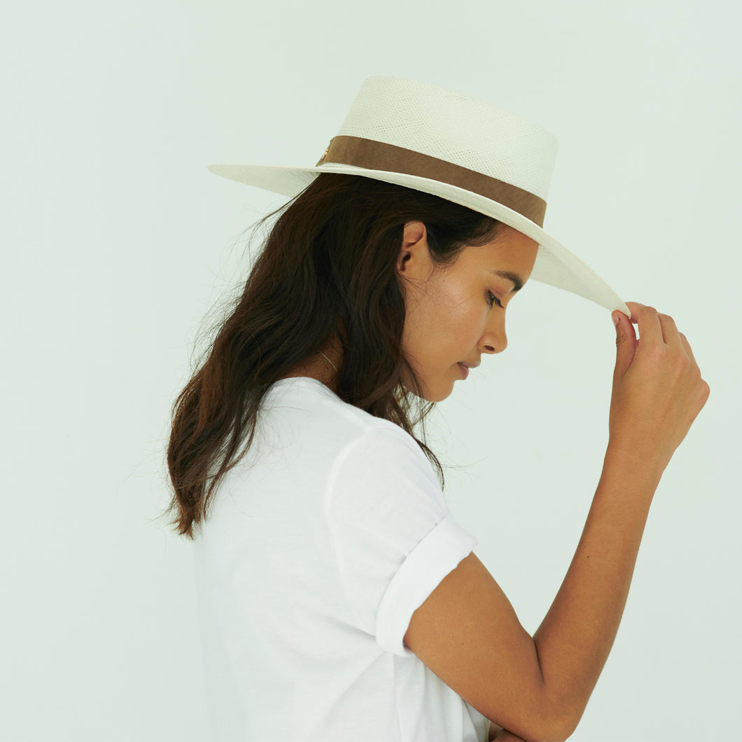 White boater straw hat with brown suede band