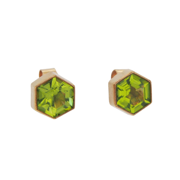 A pair of modern, 9ct yellow gold, peridot set, hexagonal stud earrings