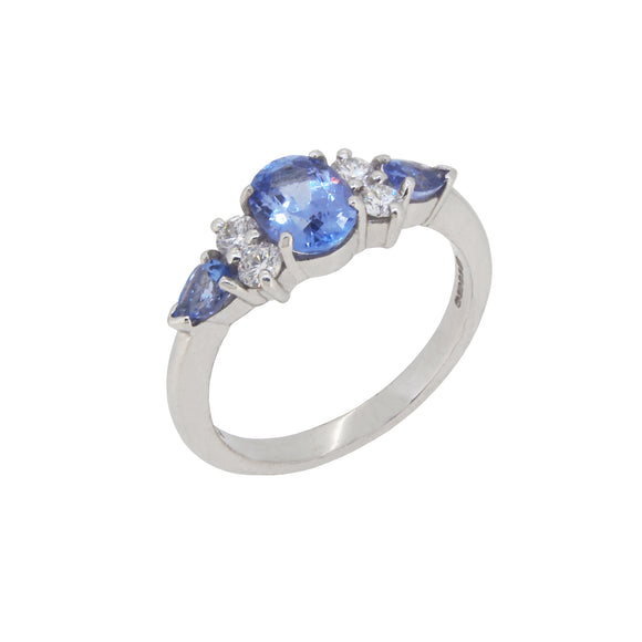 A modern, 18ct white gold, tanzanite & diamond set seven stone ring