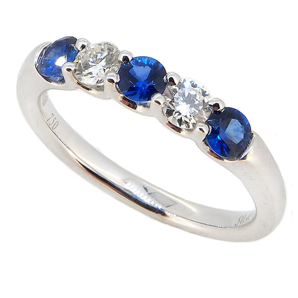 Pictured is a modern, 18ct white gold, sapphire & diamond set five stone ring