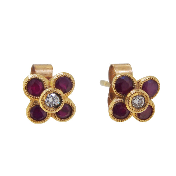 A pair of modern, 9ct yellow gold, ruby & diamond set, clover style stud earrings