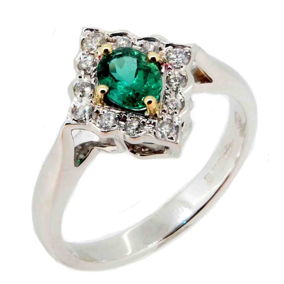 A modern, 18ct white gold, emerald & diamond set cluster ring.