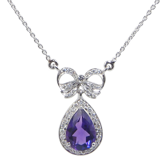 A modern, 18ct white gold, pear cut amethyst & diamond set bow necklace