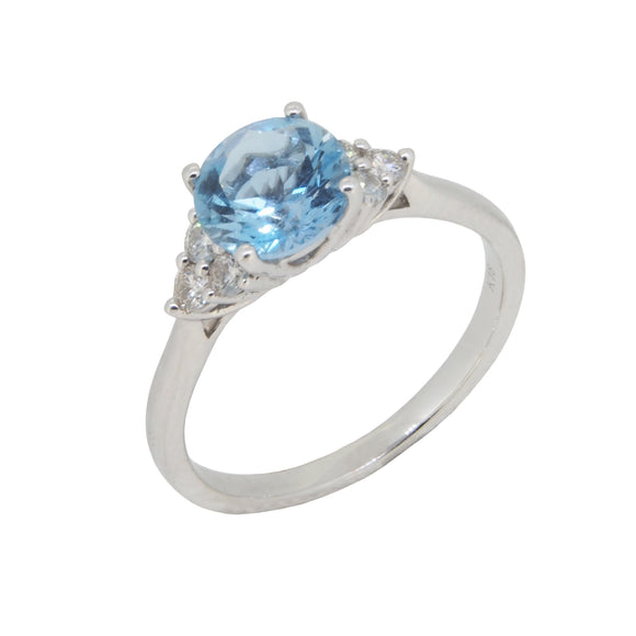 A modern, 18ct white gold, aquamarine & diamond set seven stone ring