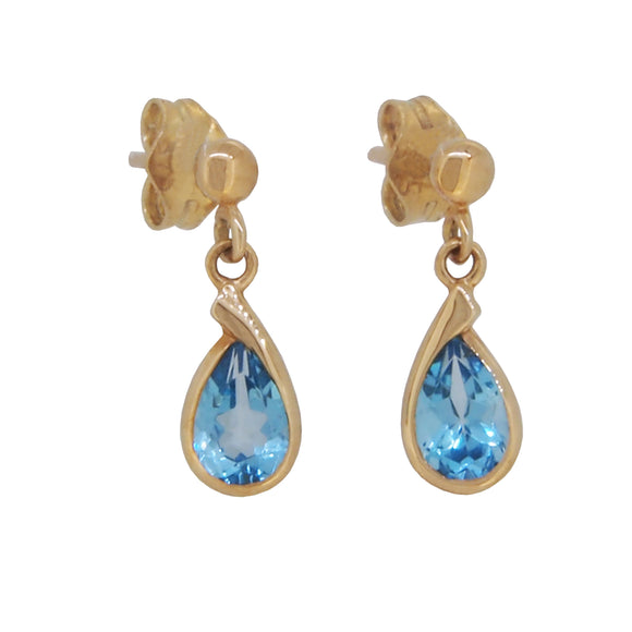 A pair of modern, 9ct yellow gold, blue topaz set drop earrings