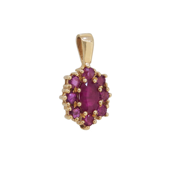 A modern, 9ct yellow gold, ruby set cluster pendant