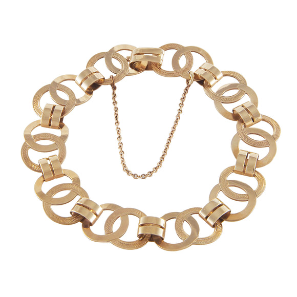 A modern, 9ct yellow gold, flat circle & oval link bracelet
