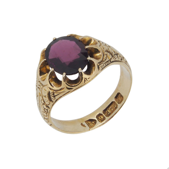 An Edwardian, 9ct yellow cold, almandine garnet set, single stone dress ring