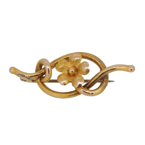 An Edwardian, 9ct yellow gold, floral knot brooch