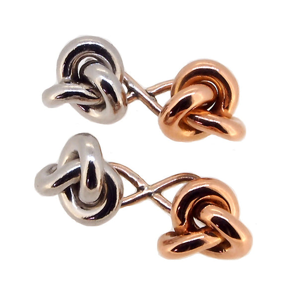 A pair of early 20th century, platinum & high carat rose gold, knot cufflinks with figure of eight links