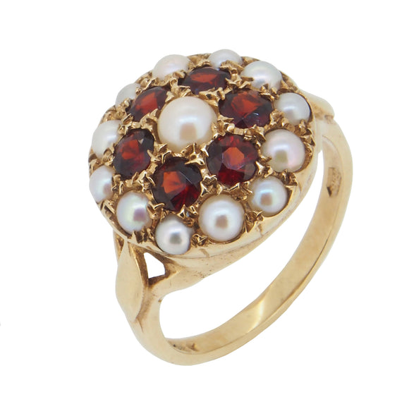 A modern, 9ct yellow gold, garnet & pearl set floral ring